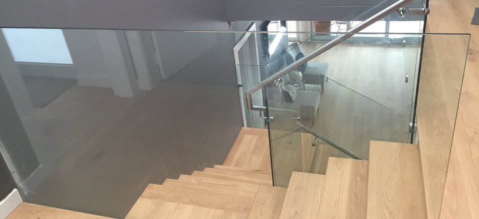 glass railing by stairs