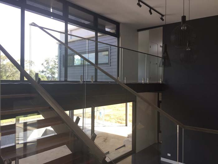 glass handrail divider on stairs