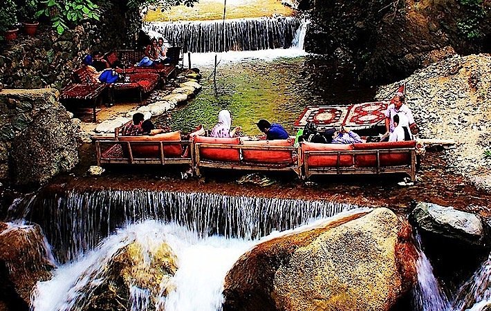 Eating food on the river,  Village of Darband in Tehran