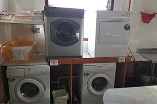 laundry room with equipment