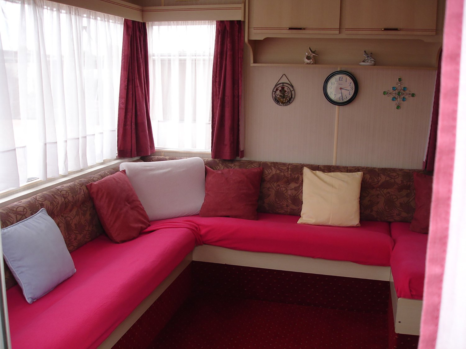 room with a red sofa with pillows