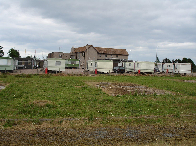 long distance view of a parking lot with caravans