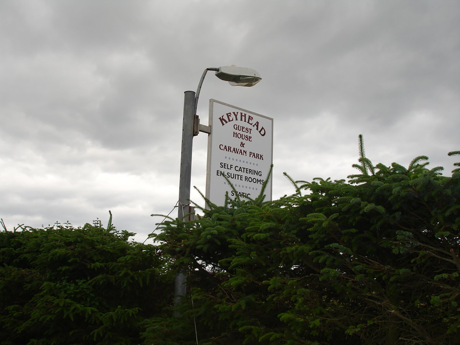 keyhead guest house sign