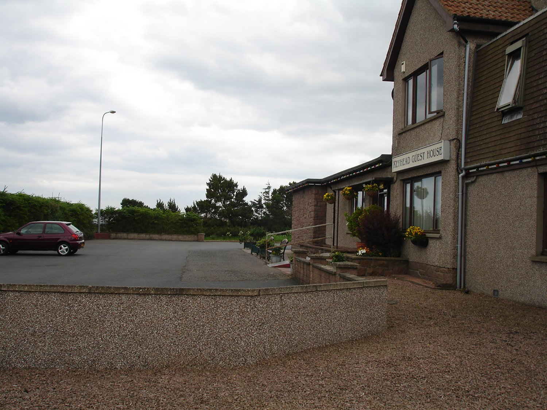 main parking lot of a front entrance building