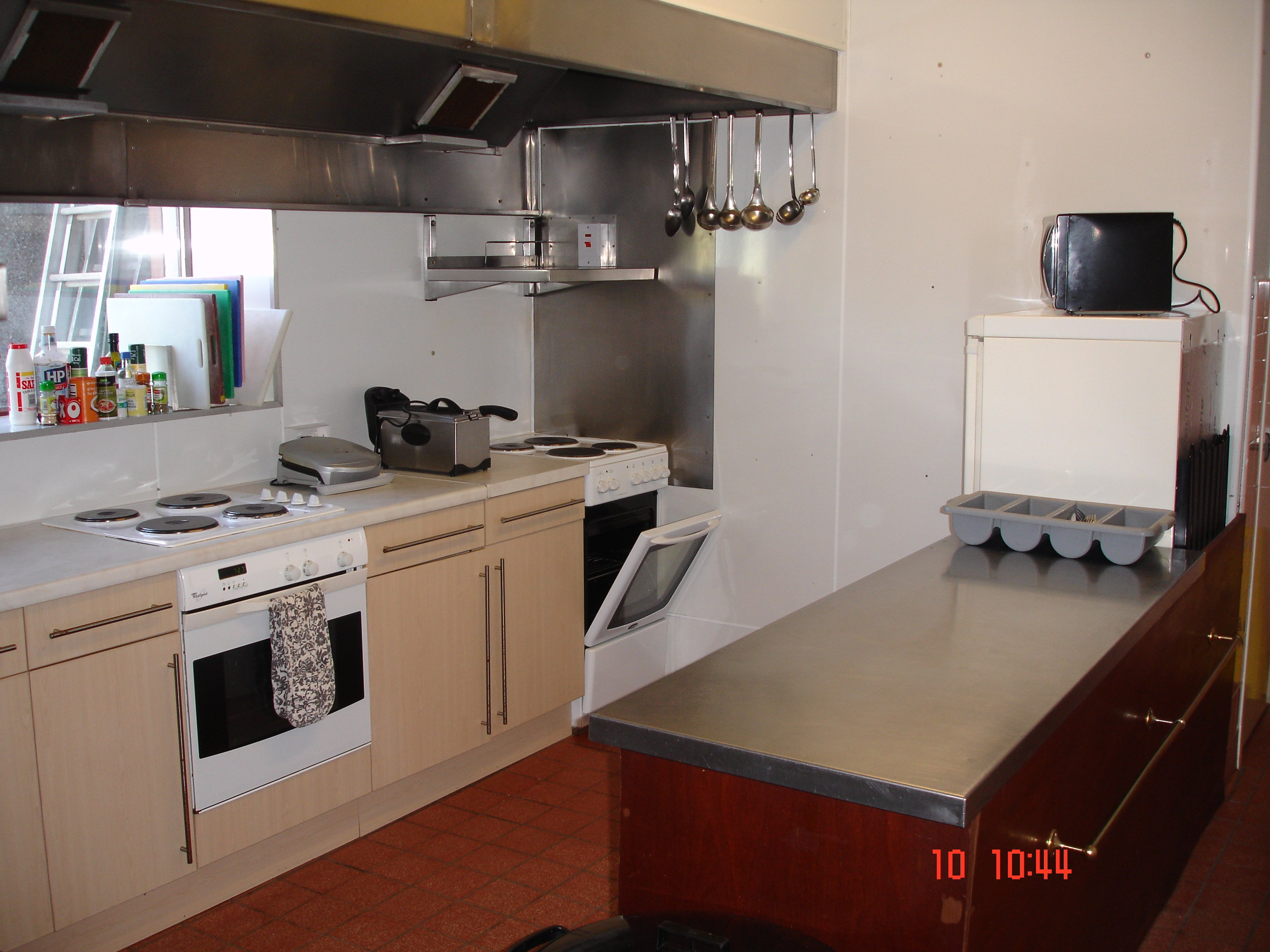 kitchen with all ustensils and white walls