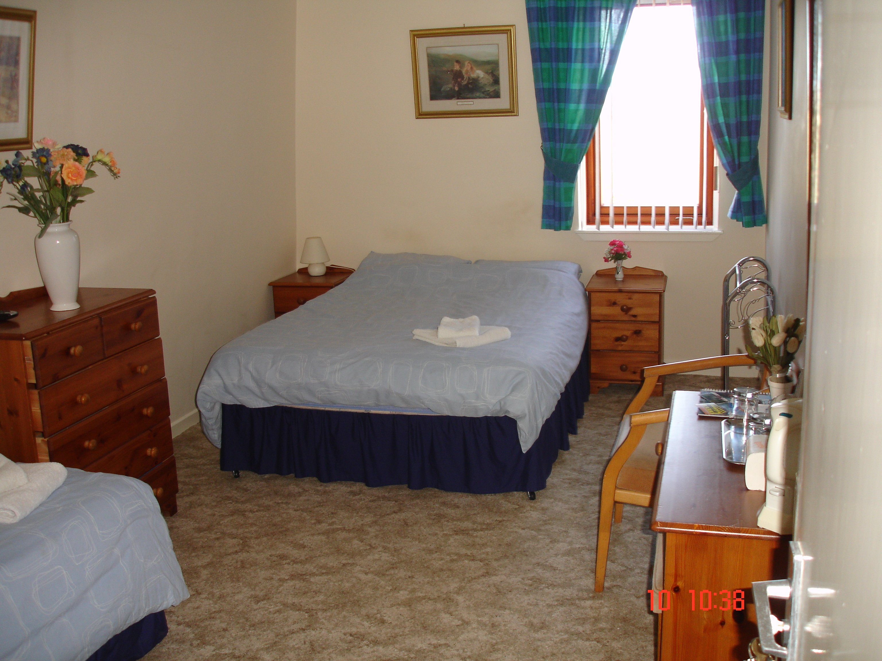 room with 2 beds and wooden furniture