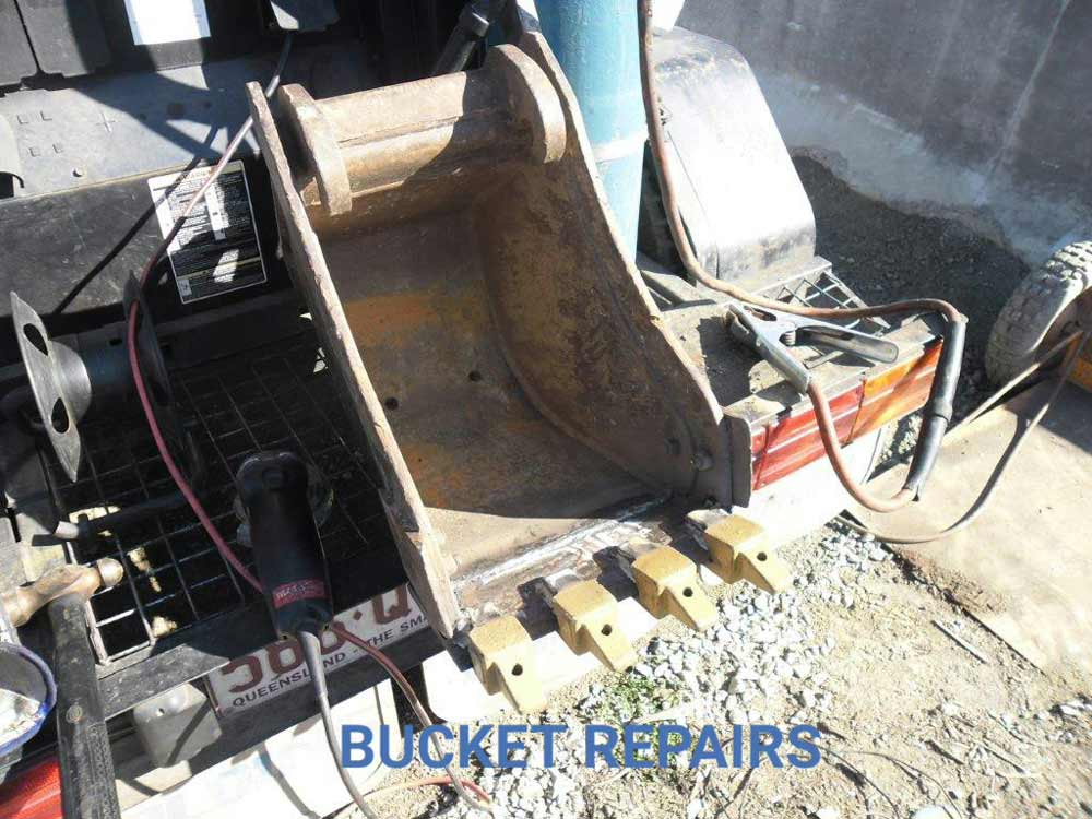 repaired bulldozer bucket with a claw
