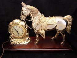 Mid century mantle clock sold at auction