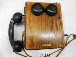 Antique bell telephone sold at auction