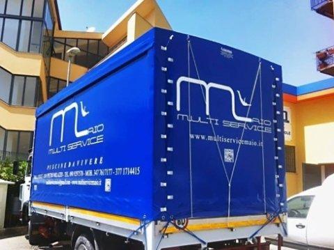 Teli su misura; telo di copertura; pvc; blu; telo completo in PVC; telo con scritta; laterali in PVC; tetto in PVC