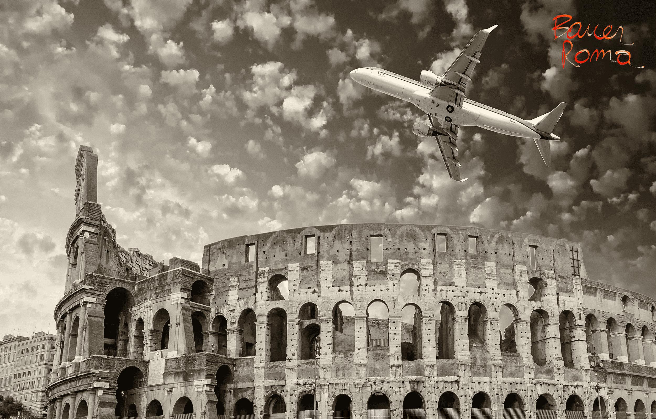 colosseo romano dal basso con aereo che vola