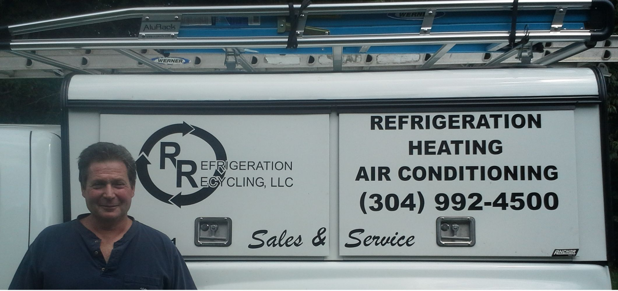 Owner of Refrigeration Recyclong, LLC in front of a service van