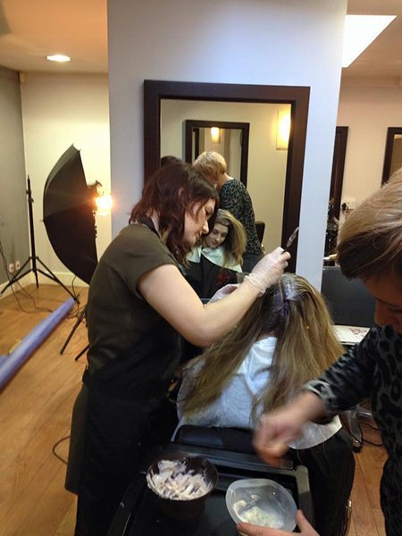 hairdresser applying hair colouring