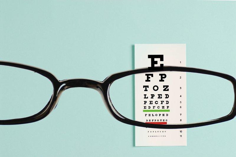 Glasses over eye exam sheet