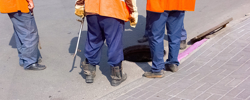 men conducting manhole inspection