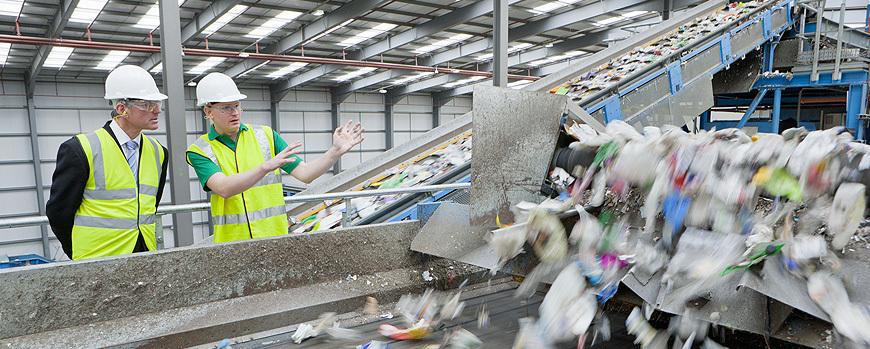 men inspecting rubbish