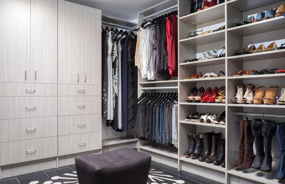 Custom Walk In Closet System With A Concrete Finish