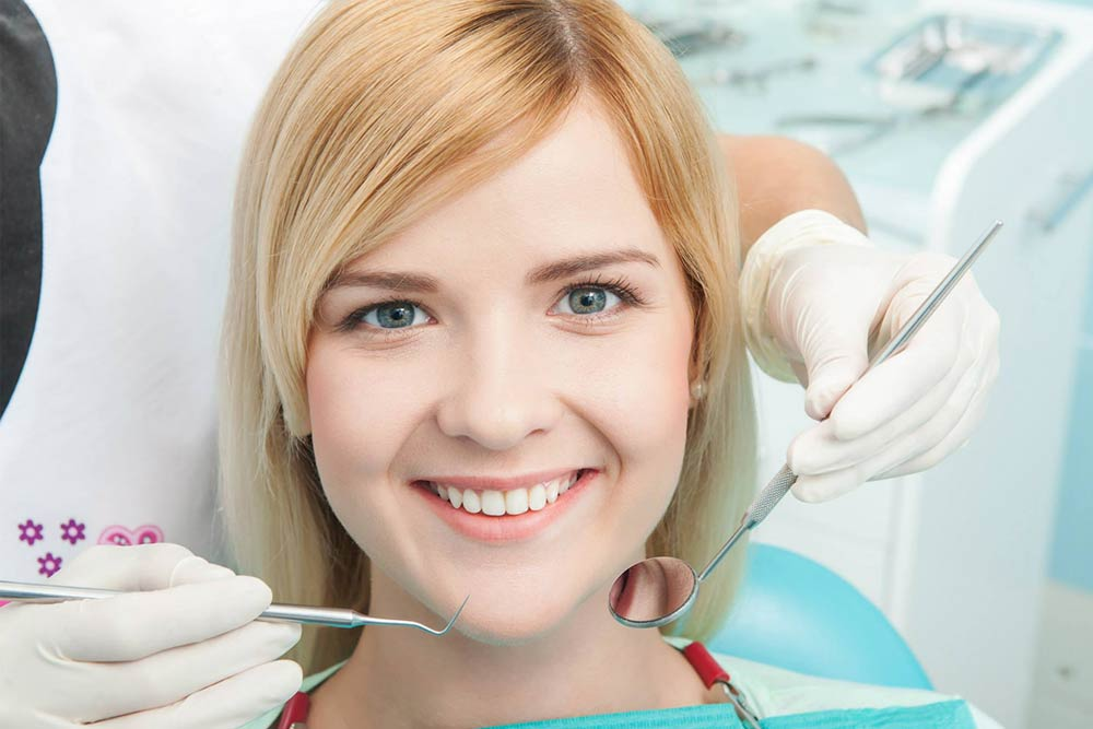 A girl visiting a cosmetic dentist in Melbourne, CBD