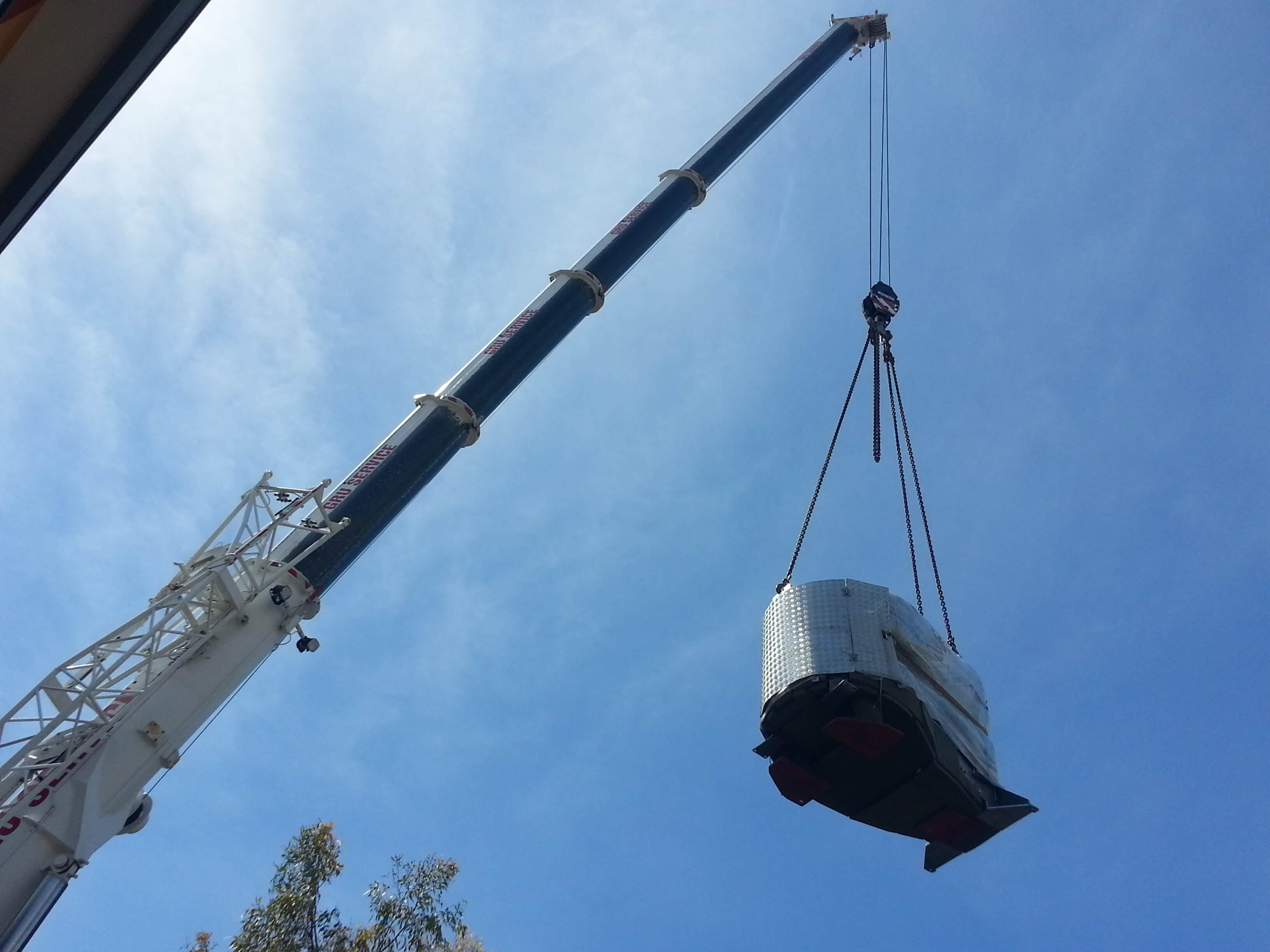 Transporting Hitachi Open using a crane
