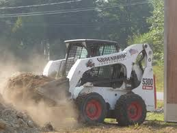 Skid steer spreading in preparation of your sod