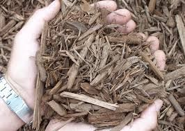 Natural organic light brown wood chips perfect for top dressing of flower beds
