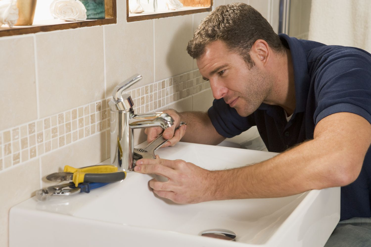 A plumber handling a home plumbing job in Anchorage, AK