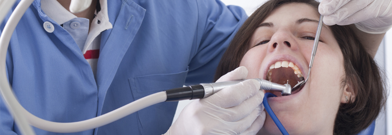 A female patient undergoing a dental treatment in Cincinnati, OH