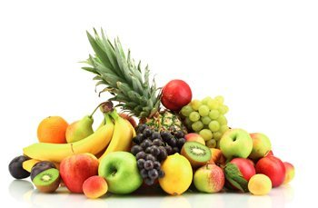 A pyramid of fresh kiwi, pineapple, lemongs, grapes and apples
