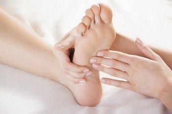 Hands examining a foot