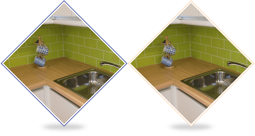Domestic kitchen with green wall tiles