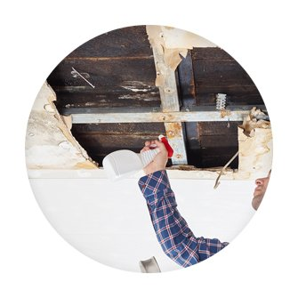 man cleaning mould