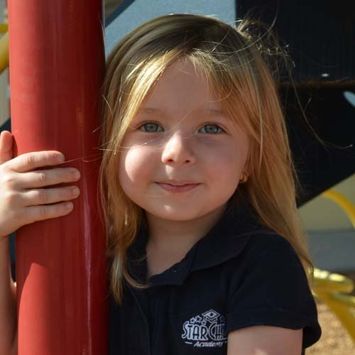 Preschool Girl on StarChild Academy's Playground