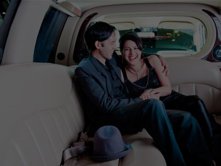 Couple enjoying being in a limousine