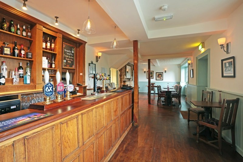 The bar area with fine ales at the George Inn, Sandy Lane, Chippenham.