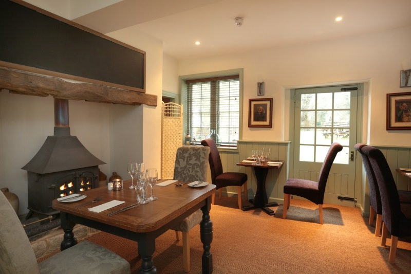 The comfortable bar area with wood burner at The George Inn, Sandy Lane, Chippenham