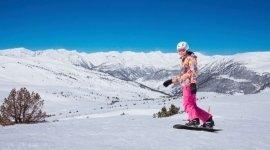 vestiario invernale da donna, vestiario tecnico da sci, guanti da snoboard
