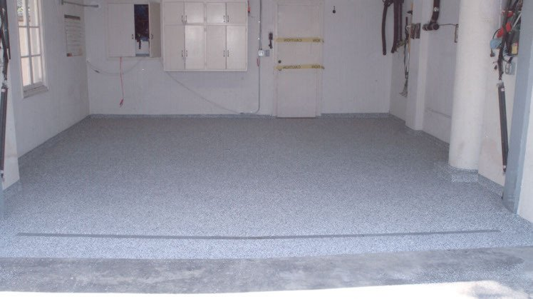 Newly expoxy-coated garage floor.  What a difference!