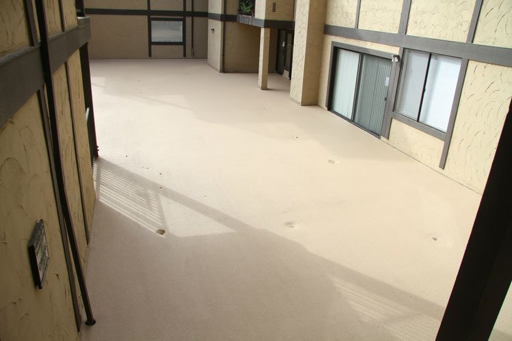 Courtyard floor after water- proofing applied