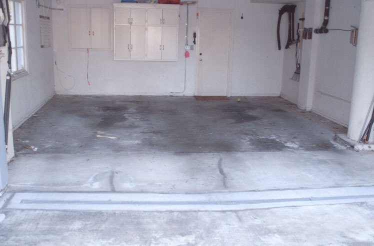 Garage floor before application of decorative epoxy coating.