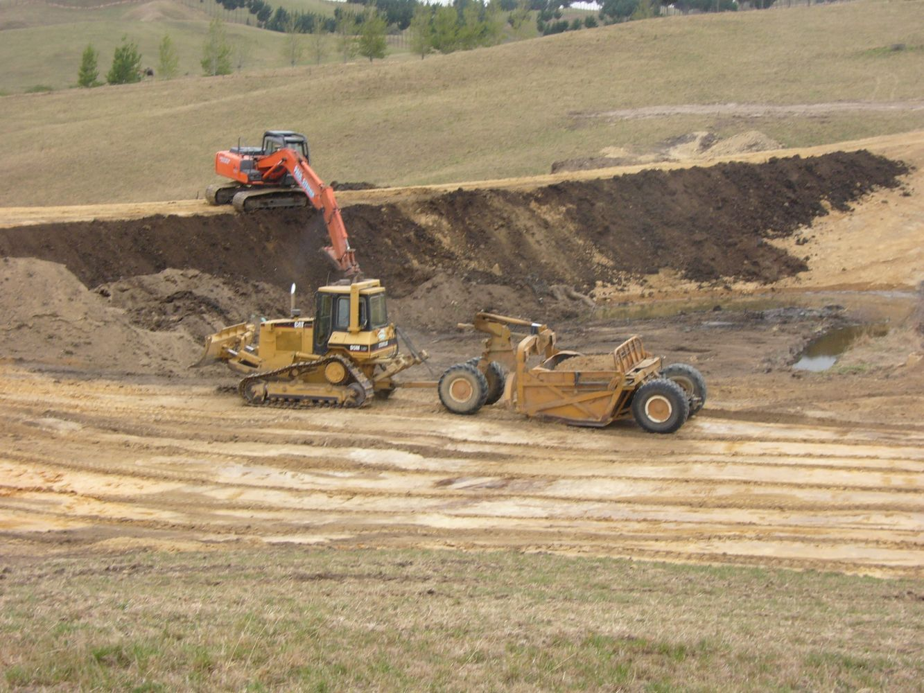 Three different earthmoving machines on site
