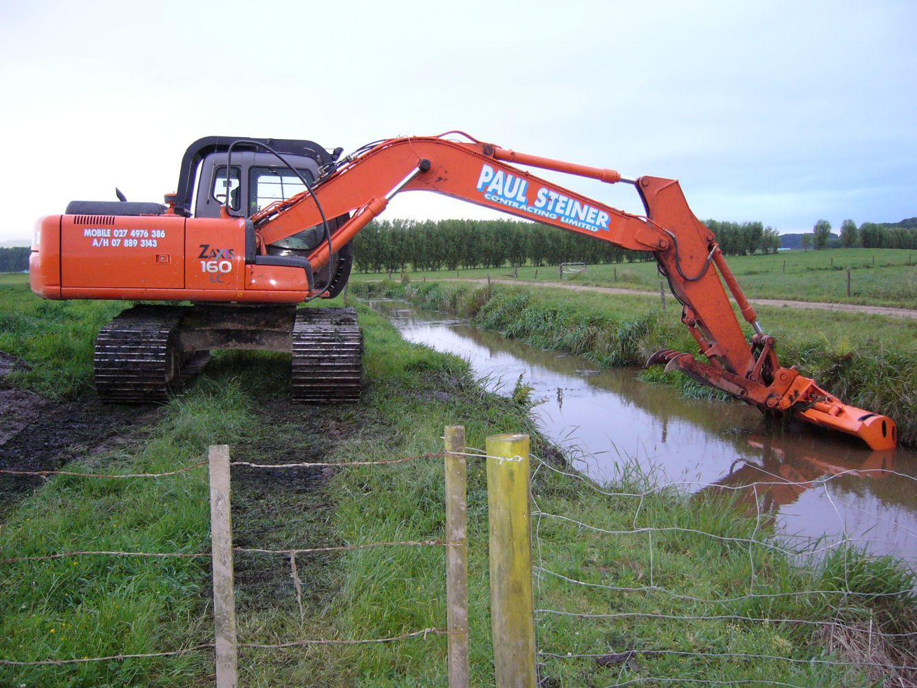 Orange earthmoving machine