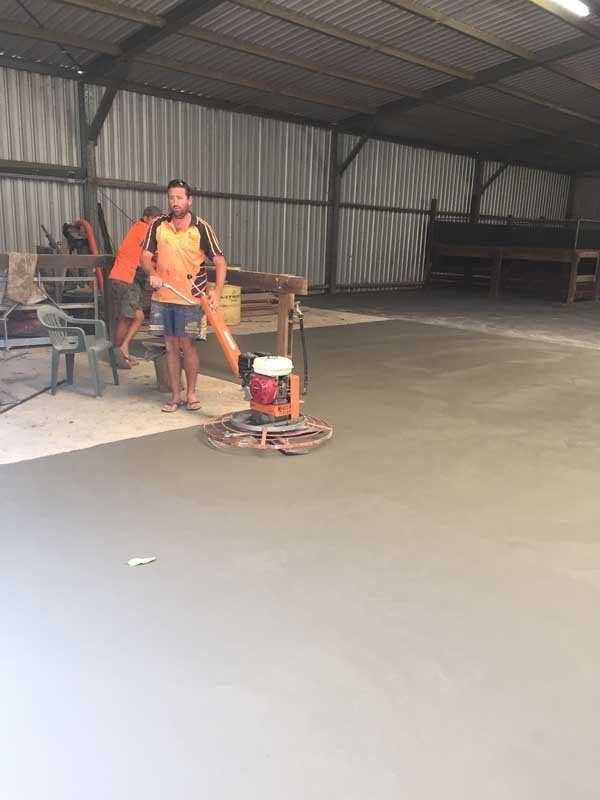 worker smoothing concrete