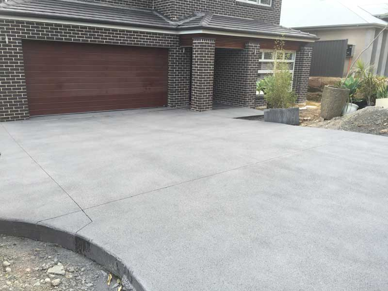 home with nice new concrete driveway
