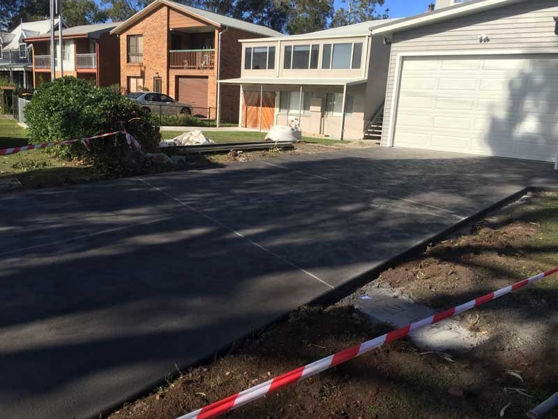 home with new concrete driveway
