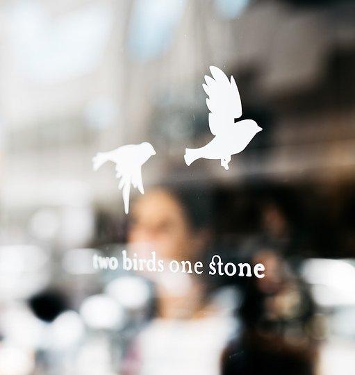 two birds one stone cafe window
