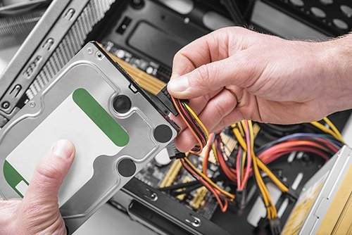 Killa-Byte technician linking up a new internal hard drive