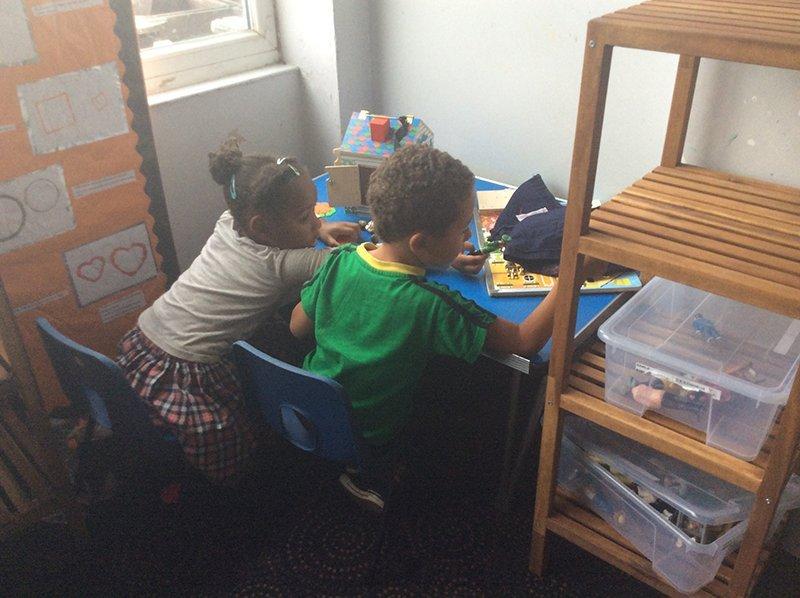 2 kids studying