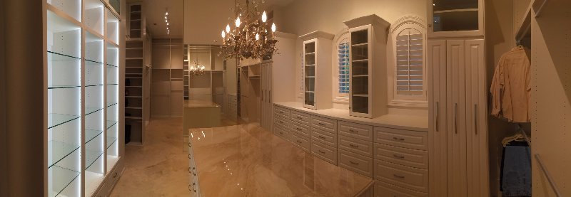 Traditional Master Closet With Granite Island
