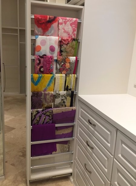 master closet with pull out scarf rack