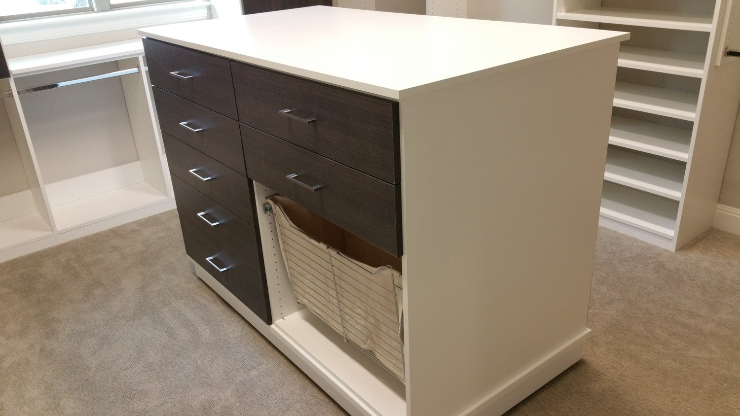 moveable closet island with pull out laundry storage